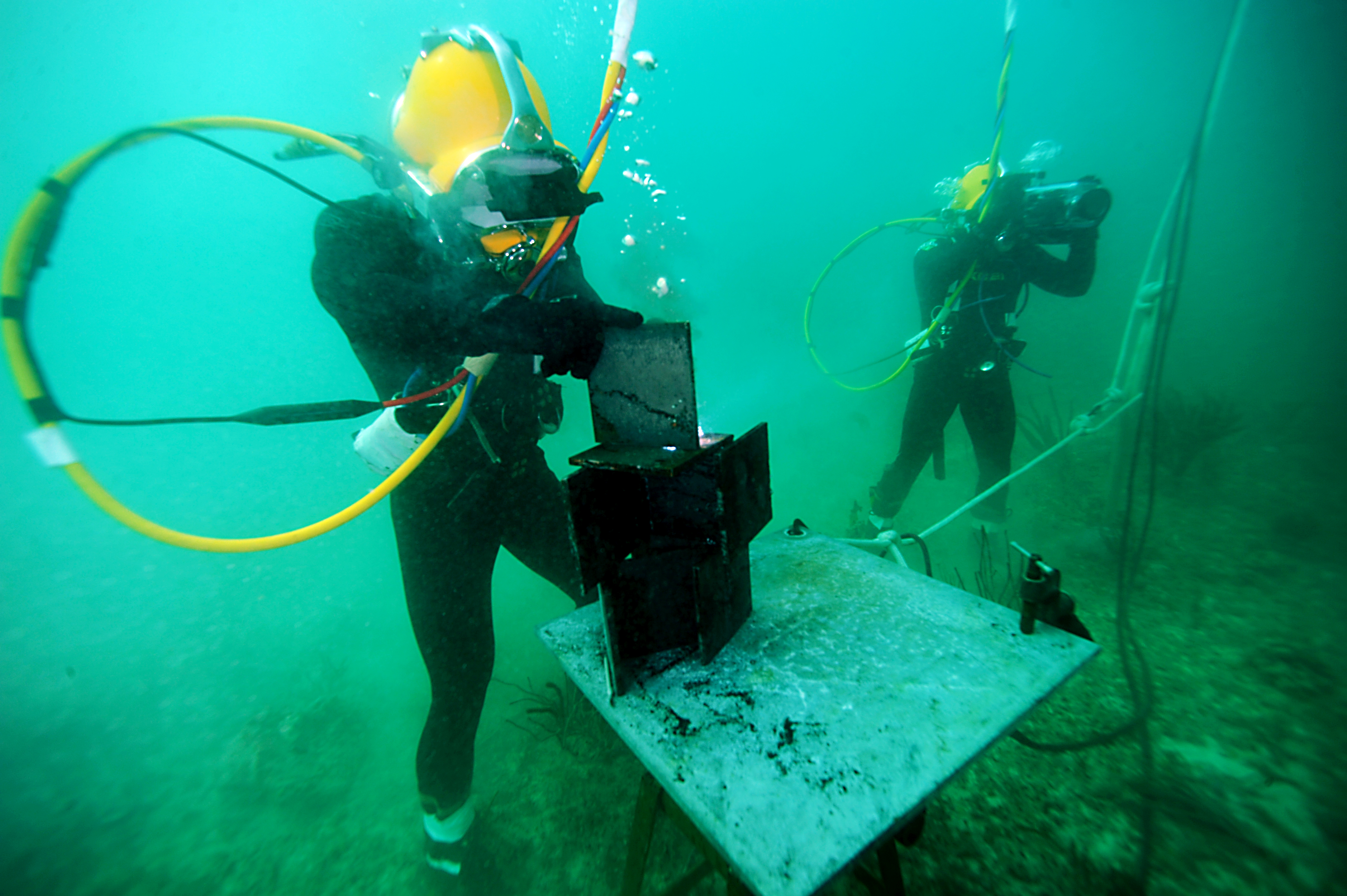 Navy diver as uses an underwater welding torch
