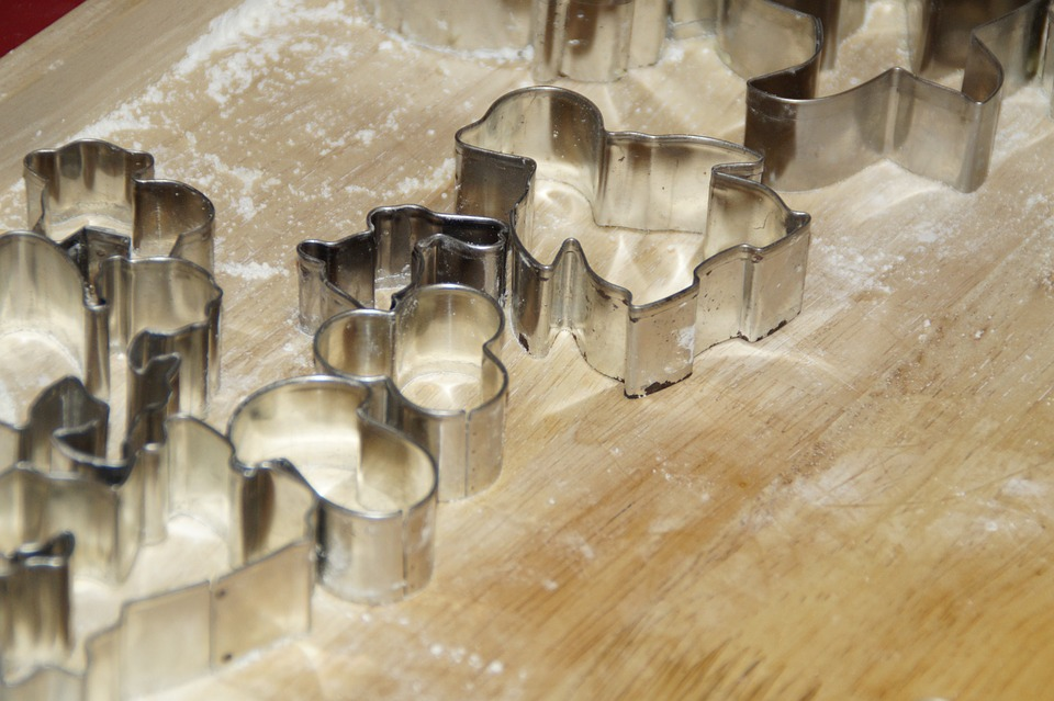Cookie Cutters on a Wooden Table with flour Showing The Use ofPot Metal Welding