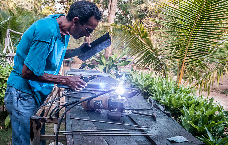 Fully-Equipped Welder who troubleshoots Stick Welding Issues on a garden backyard