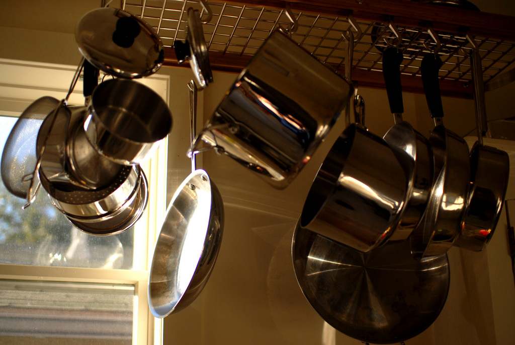 Rack with Stainless Pots on a Kitchen Showing The Use ofPot Metal Welding