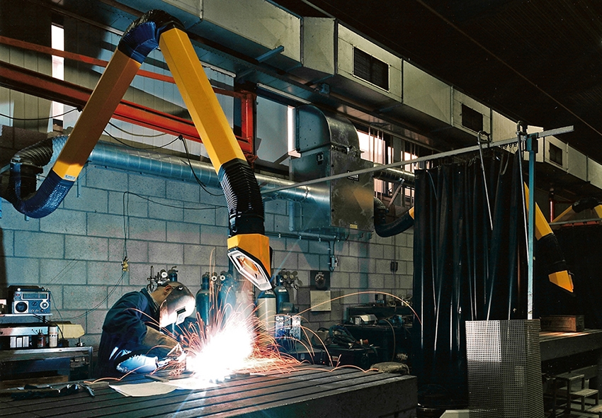 a welder using a fume extractor