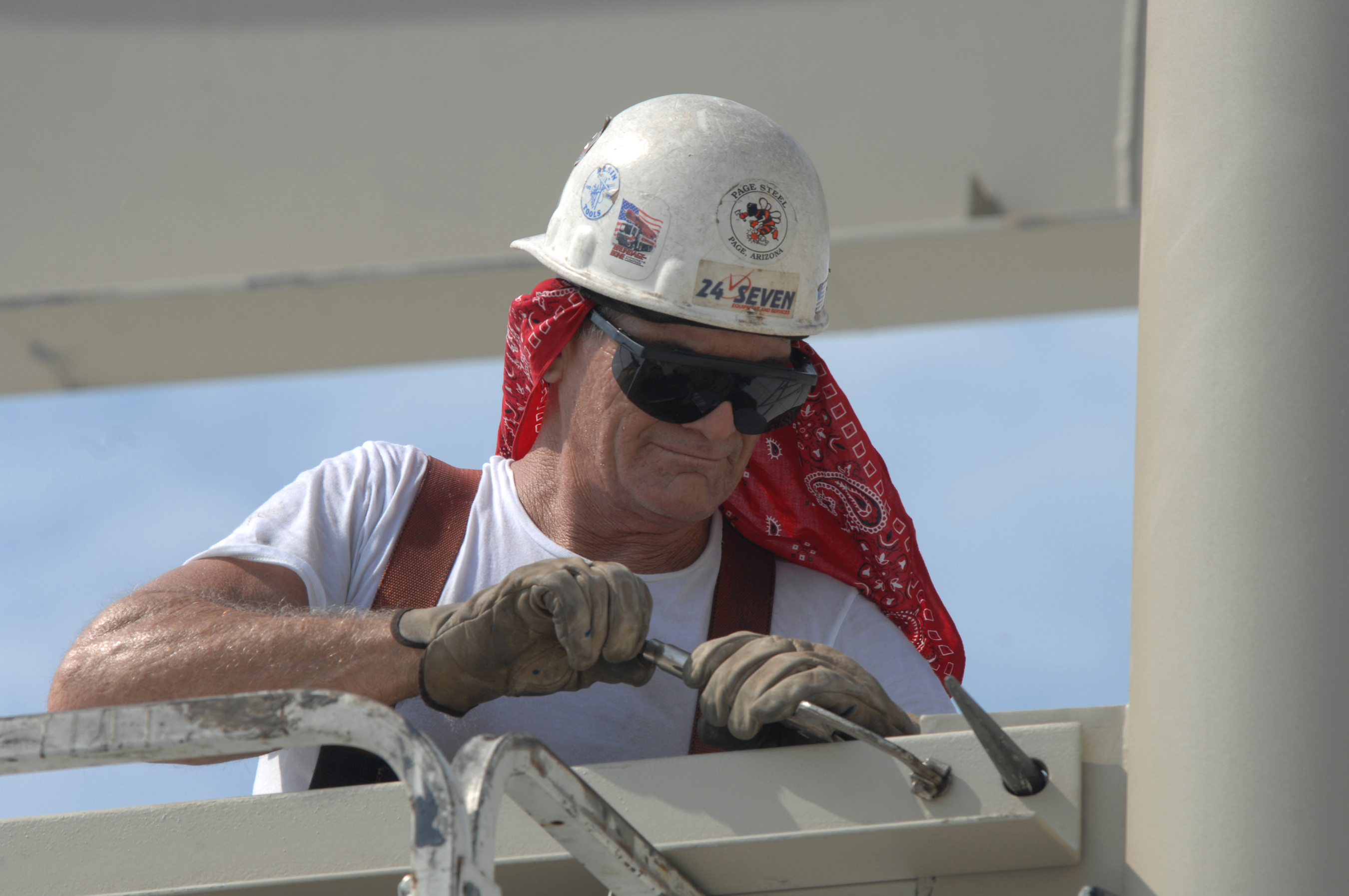 worker wearing safety glasses and helmet
