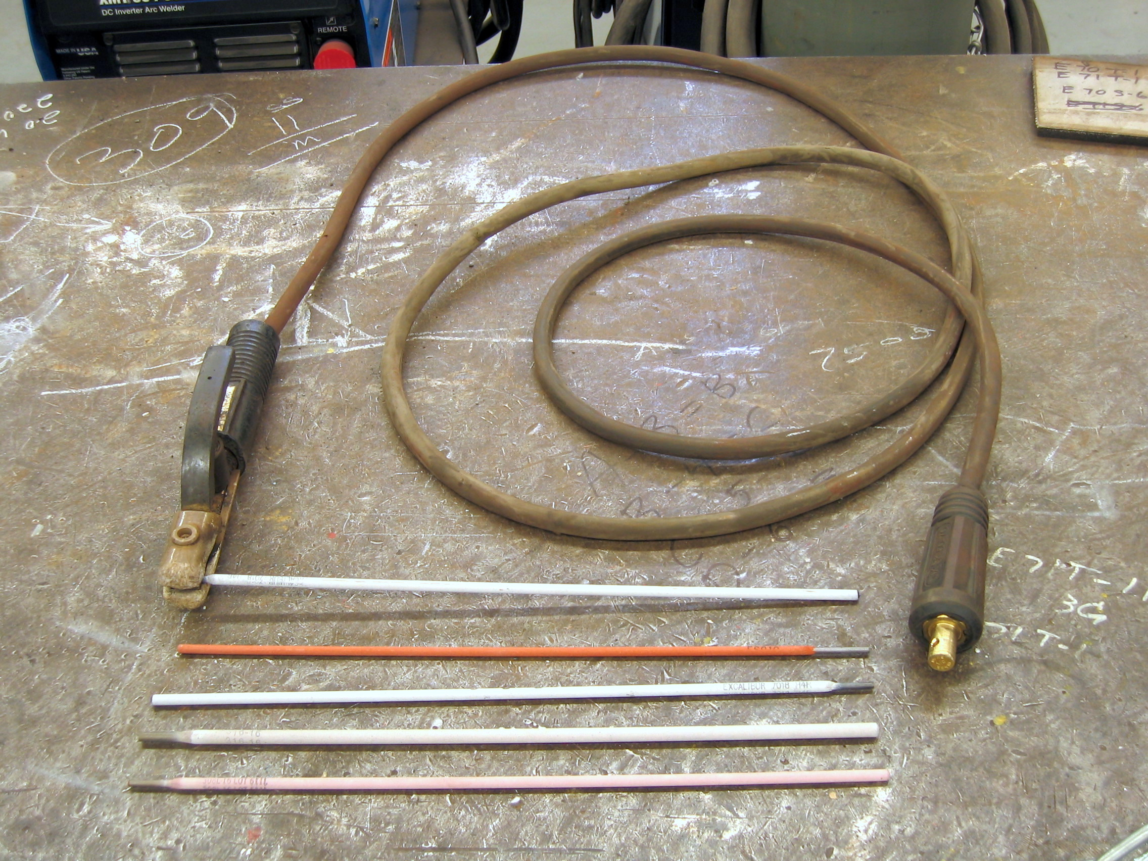Various Shielded Metal Arc Welding electrodes and an electrode holder which uses Welding Rod Chart as a guide