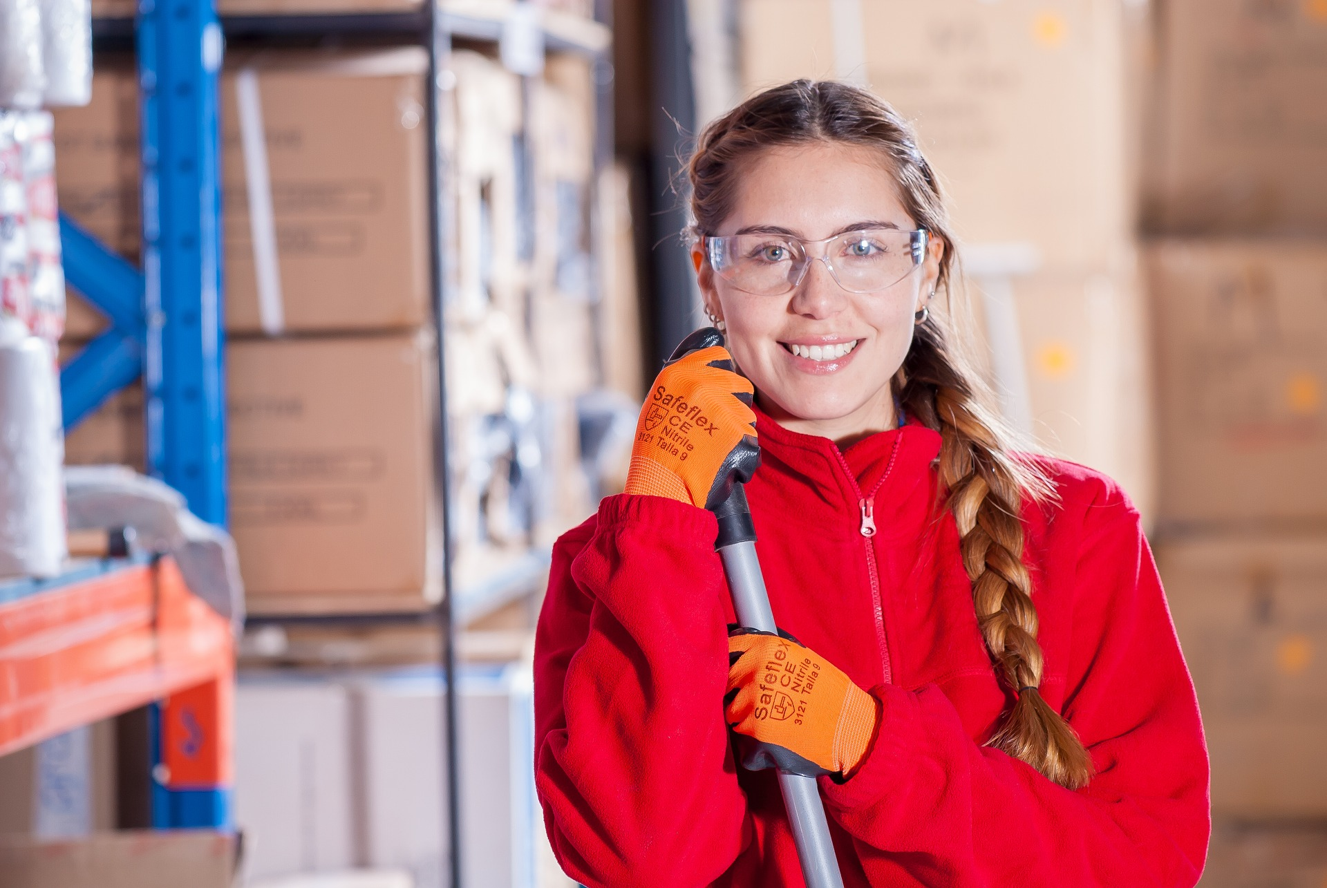 Woman wearing red while holding a cleaning material